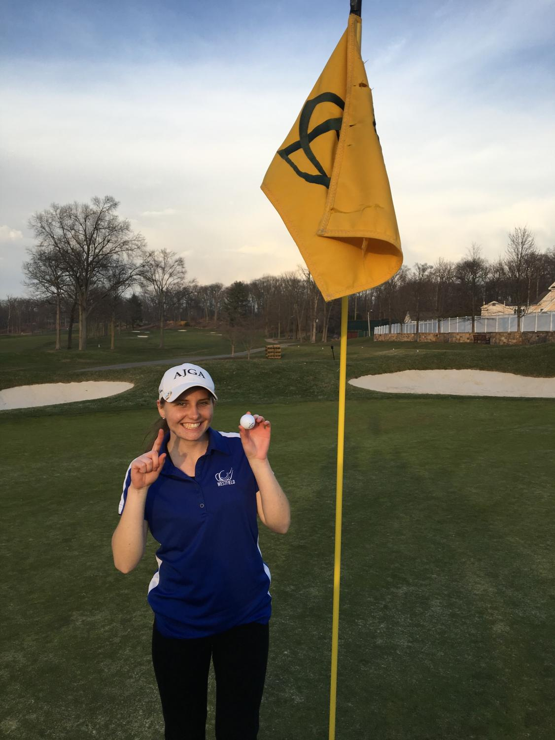 Junior Anna Bowman poses after making a hole in one.