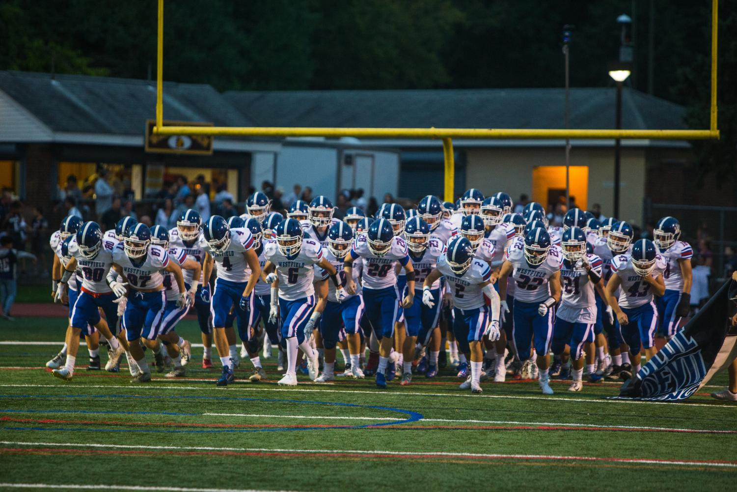 The football team takes the field prior to its game against Watchung Hills on Sept. 14.