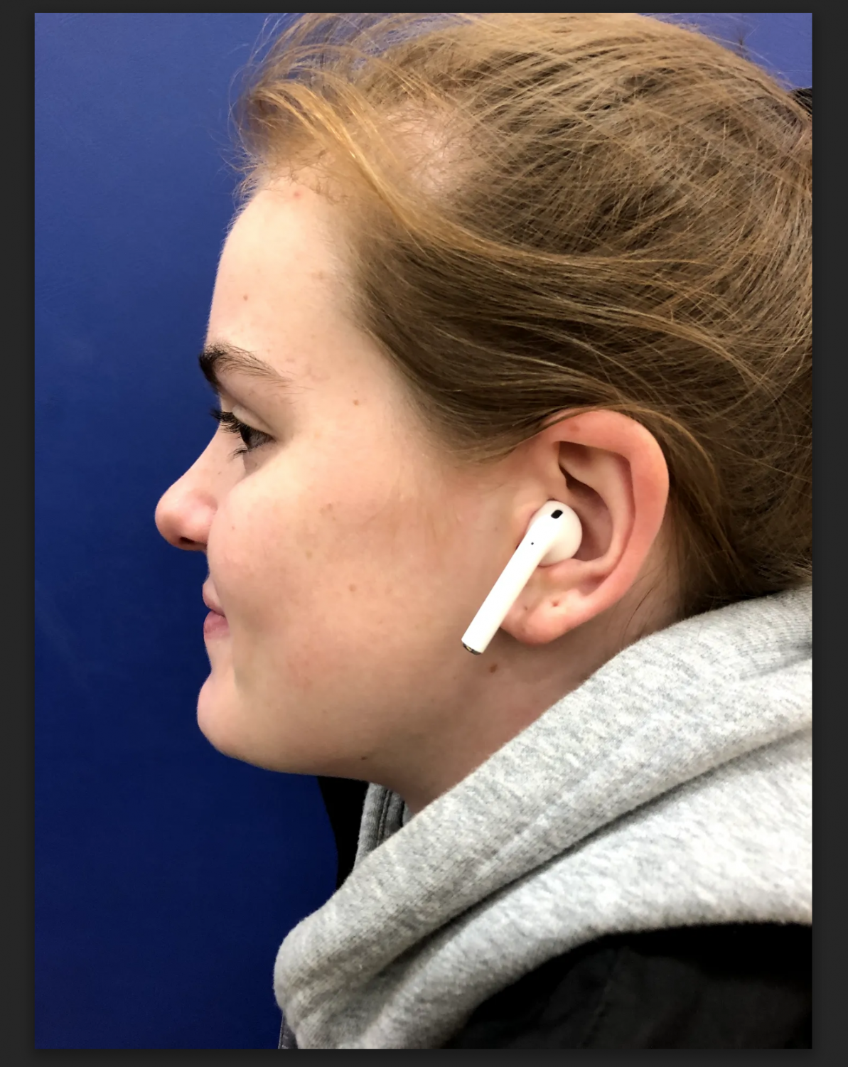 Senior Lily Maz wearing AirPods