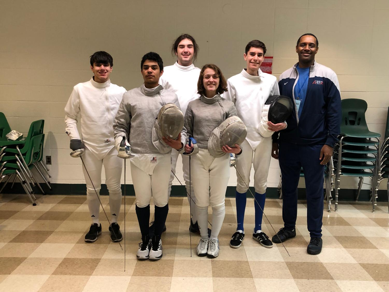 Members of the Fencing Club at a meet earlier this year.