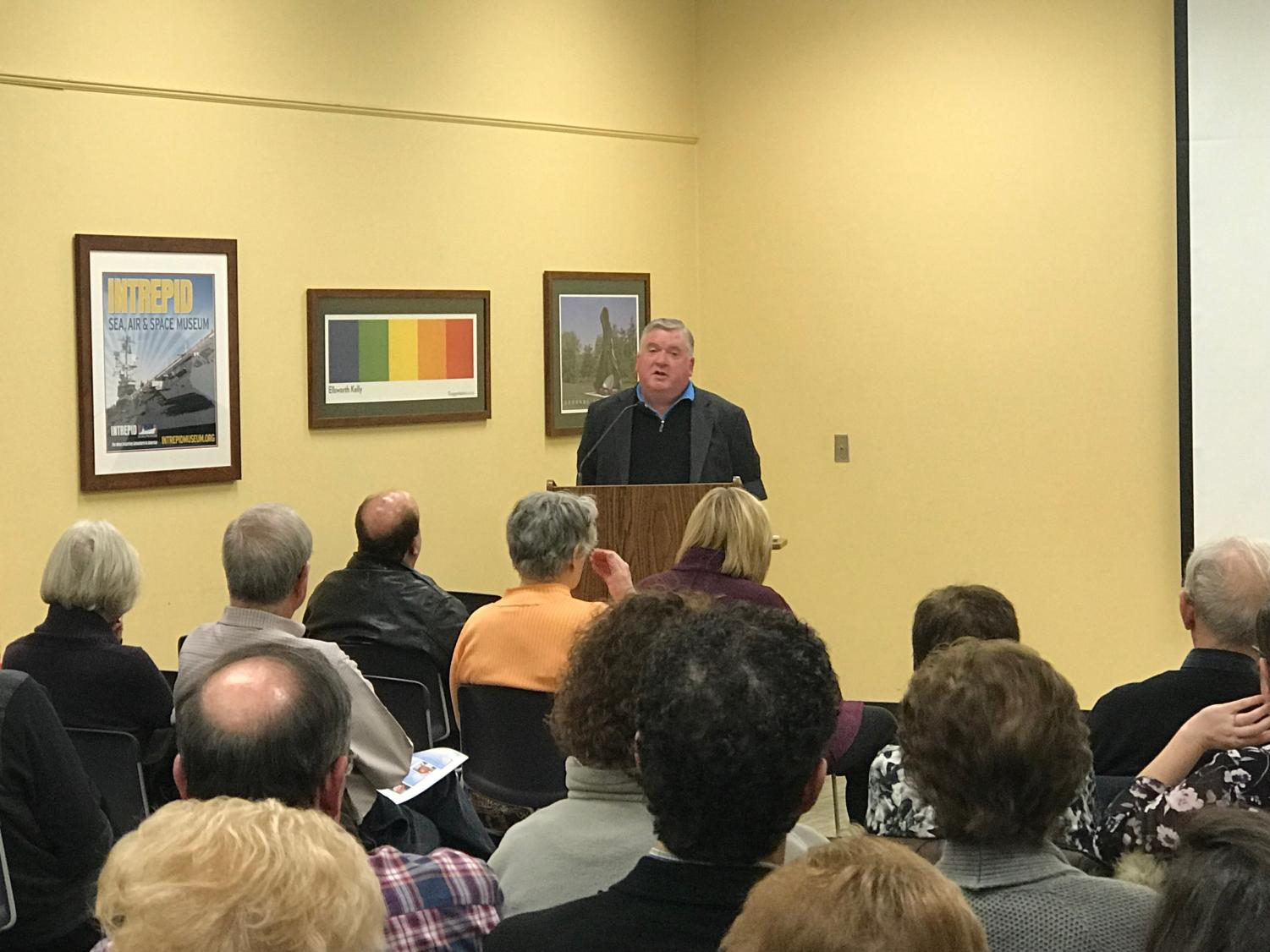 Reporter Joe Nolan speaks to the community at the Westfield Memorial Library as a part of the Hale Speaker Series.
