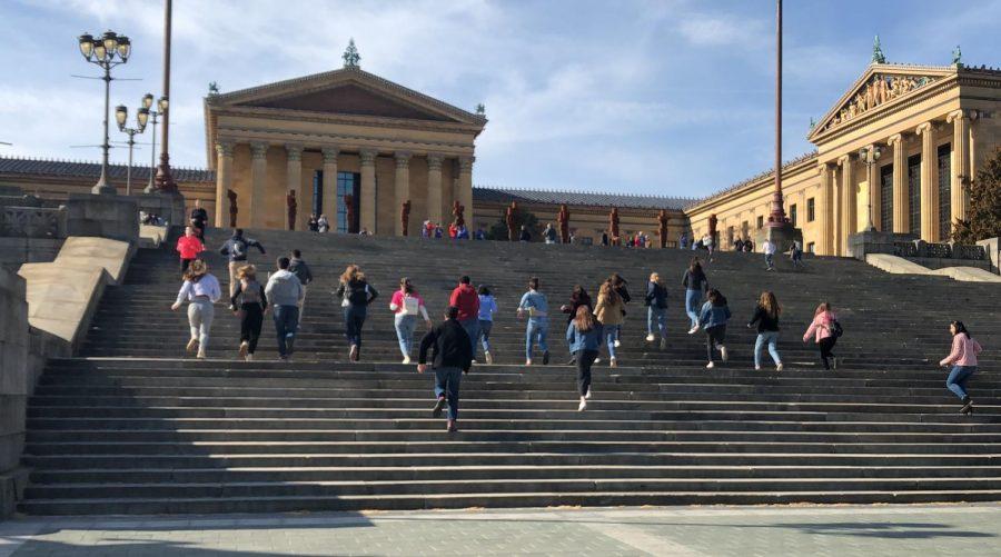 Hi's Eye staff runs up the Rocky steps.