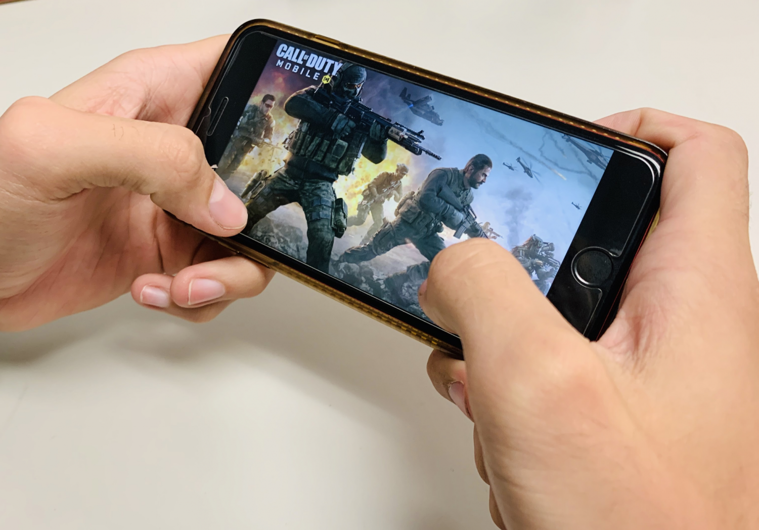 Student playing Call of Duty Mobile in the Student Center