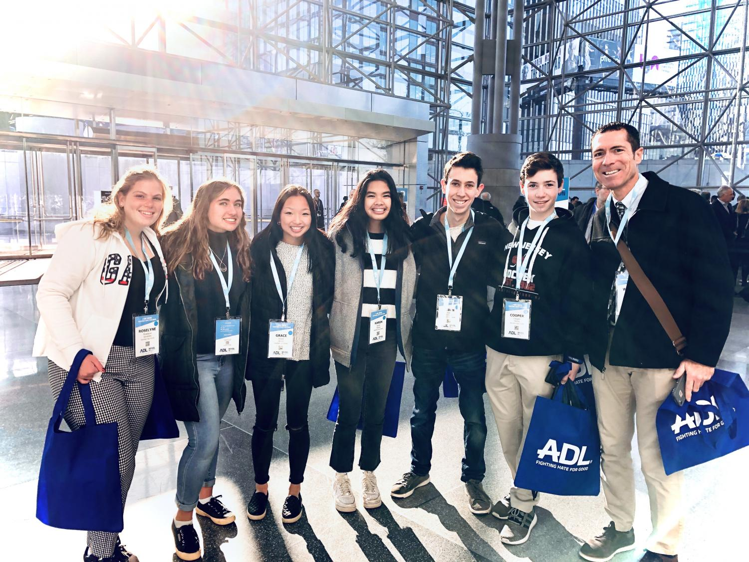 Grace Sacco with WHS students and Assistant Principal Warren Hynes at The Never is Now Summit