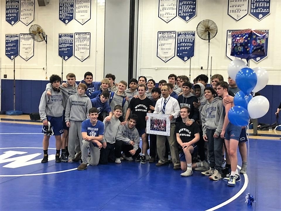 WHS wrestling team celebrating their win on Wednesday night