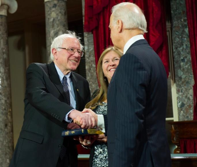 Bernie Sander and Joe Biden shaking hands