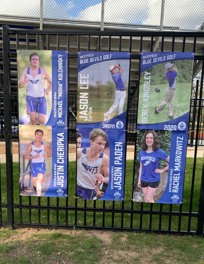 Parents+set+up+banners+at+Kehler+Stadium+to+honor+senior+athletes