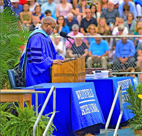 Dr. Derrick Nelson speaking at graduation 2018