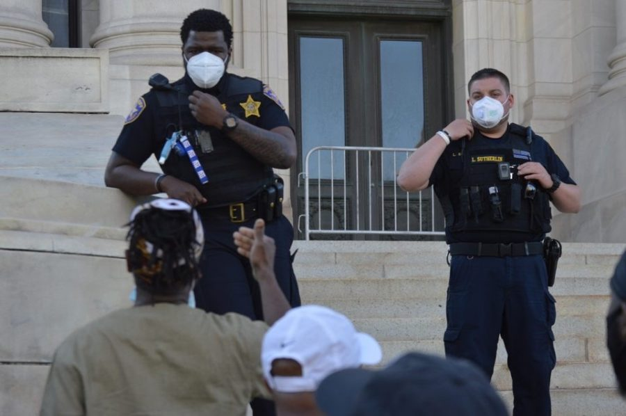 A protestor talking to police officers during a protest in Newark on May 30