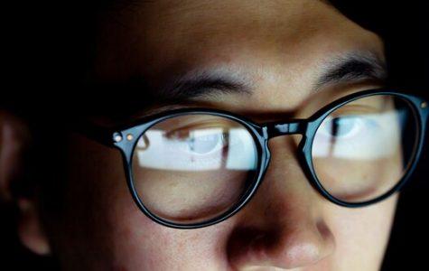Man wearing blue light glasses