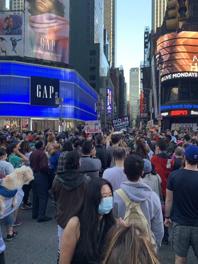 People celebrating Biden and Harris' win in Times Square, NYC.