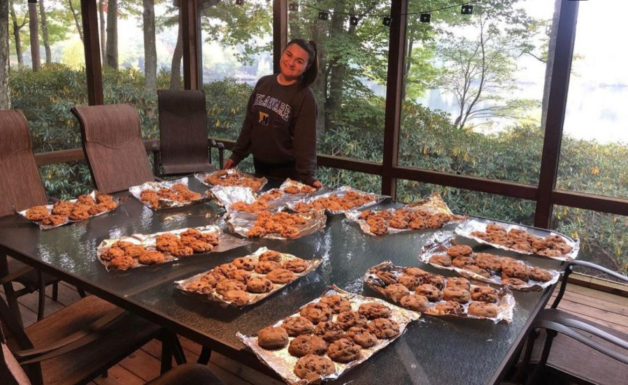 WHS Senior and owner of Fat Dog Cookie Amanda White with her cookies.