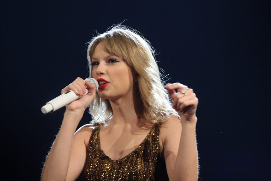 Taylor Swift performing at the Speak Now Tour.