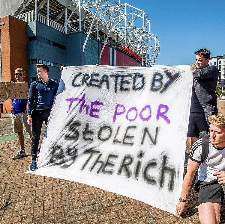Manchester United fans protest the new European Super League outside Old Trafford on April 19.
