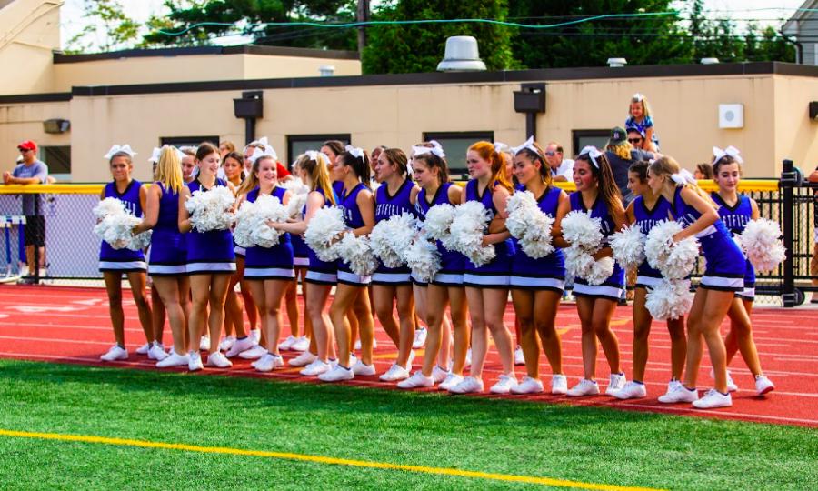 Varsity+cheer+team+at+WHS+football+game+on+Sept.+11